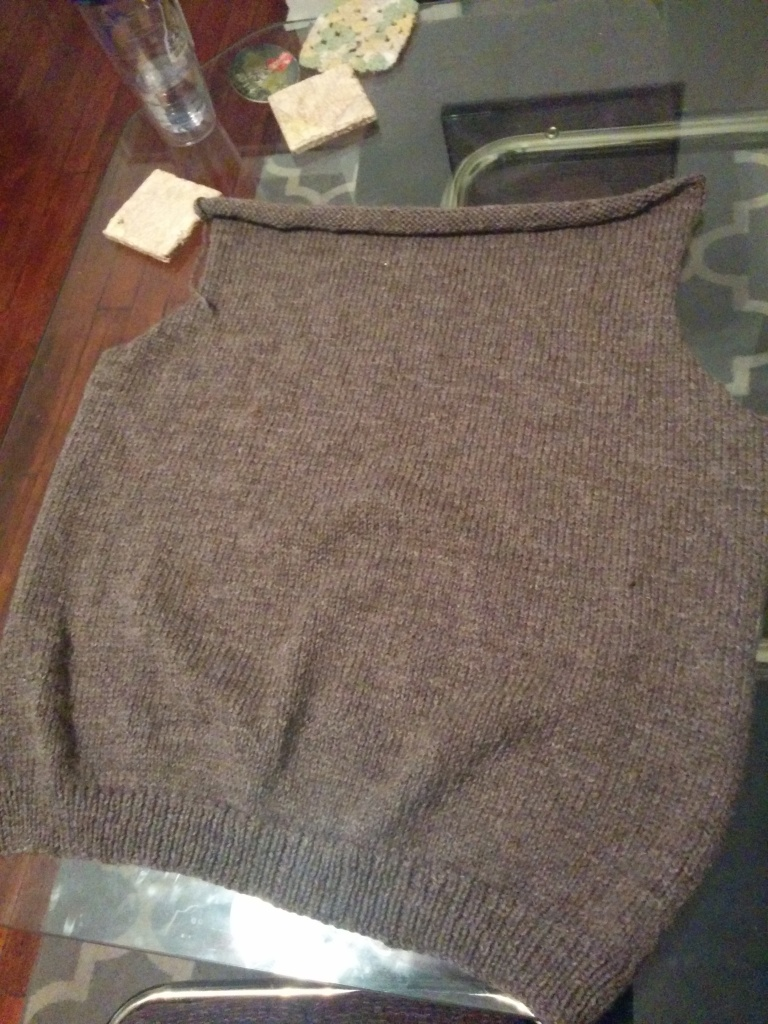 The back portion of a hand knit sweater