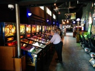 Wall of pinball machines