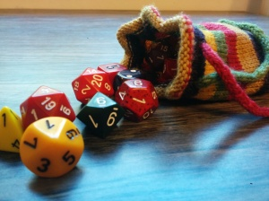 Ber knit cool dice bags for all the players. Mine has colors inspired by the fourth Doctor's scarf.