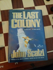 The Last Colony by John Scalzi, hardcover, on a chess board