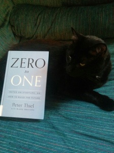 Zero to One in hardcover with avid reader cat, Bagheera