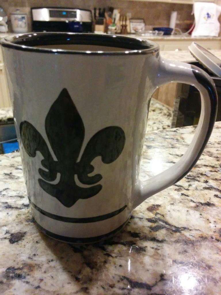 A coffee mug made by Louisville Stoneware